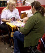 Liz reads cards at the Expo